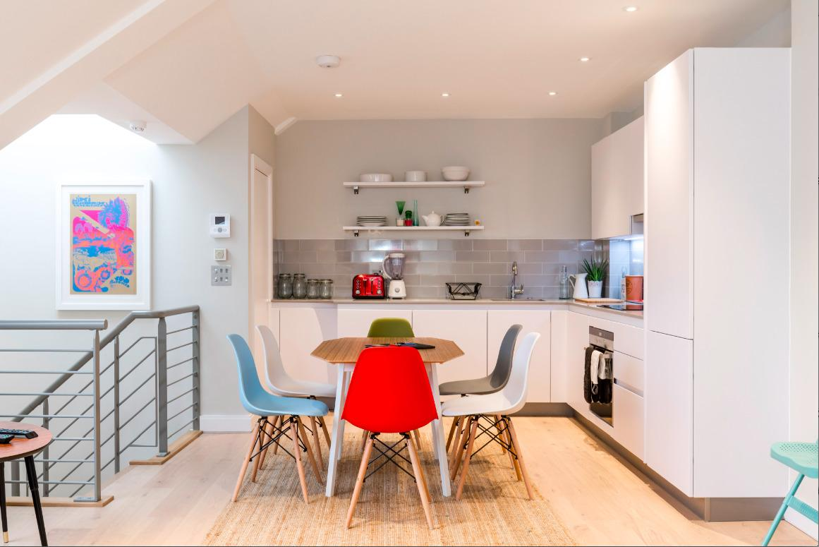 charming dining area and kitchen of London Hanbury Street 2BR luxury apartment