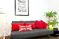 cool couch with Union Jack pillow in London Charming and Modern Camden luxury apartment