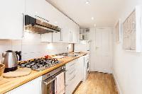 elegant whitewashed kitchen in Designer Central London Home