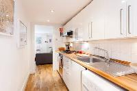 lovely kitchen with modern appliances and delightful cabinets in Designer Central London Home