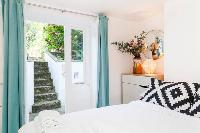 nice bedroom with doors to the garden of Designer Central London Home