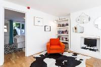 awesome orange chair in Designer Central London Home