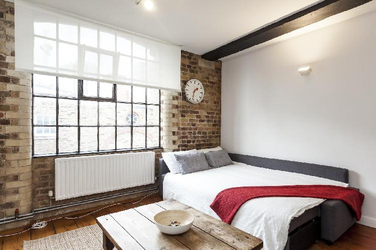 spacious, well-appointed bedroom in London Stylish Warehouse luxury apartment