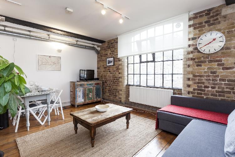 beautiful open-plan living room of London Stylish Warehouse luxury apartment