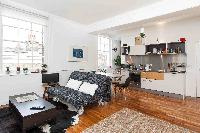 polished flooring of open-plan living room in London Boutique East London Home luxury apartment