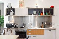 late-model appliances and a sleek backdrop in the kitchen of London Boutique East London Home luxury