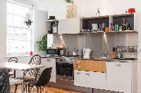sleek steel kitchen backsplash in London Boutique East London Home luxury apartment