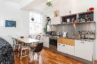 nifty dining area and kitchen of London Boutique East London Home luxury apartment
