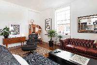 impressive sofa in the living room of London Boutique East London Home luxury apartment