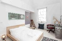 relaxing and refreshing bedroom of London Boutique East London Home luxury apartment