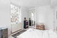 pristine room with large bed in London Boutique East London Home luxury apartment