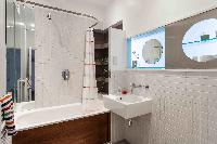 neat bathroom with tub in London Boutique East London Home luxury apartment