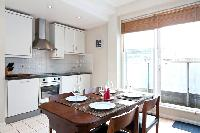 sunny and airy dining area of London City of London Penthouse luxury apartment