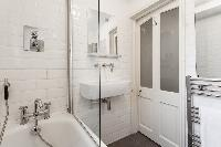 fresh and clean bathroom with tub in London Stylish Islington luxury apartment