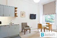 cool dining area by a large window in London Doughty 2 Bedroom luxury apartment