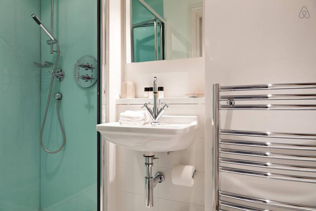 clean and fresh toilet and bath in London Doughty Double Studio luxury apartment