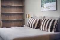 pristine pillows and bed sheets in Barcelona - Luxury Cornelia luxury apartment