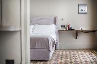 pristine bed sheets and pillows in Barcelona - Luxury Cornelia luxury apartment