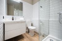 neat and trim toilet and bath in Barcelona - Luxury Cornelia luxury apartment
