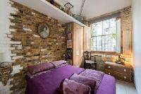 plush bed and awesome brick wall in London Framery Loft luxury apartment