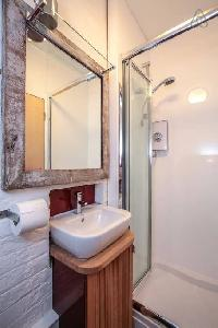 neat and fresh shower area in London Framery Studio Workshop luxury apartment