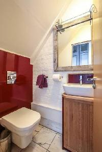 neat and trim toilet and bath in London Framery Studio Workshop luxury apartment