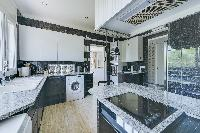well-appointed kitchen of Cannes - Palm Spring Villa luxury apartment