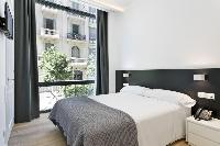 amazing bedroom with balcony at Barcelona - Palou Deluxe 1 luxury apartment