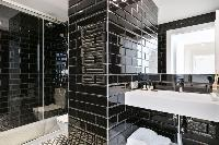 dapper bathroom with rain shower in Barcelona - Deluxe Palou Superior Apartment luxury holiday home