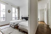 second bedroom with two single beds in a 2-bedroom Paris luxury apartment