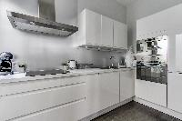 modern and fully equipped kitchen in a 2-bedroom Paris luxury apartment