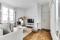 stylish 2-bedroom Paris luxury apartment with high ceilings, original wooden floors and long French