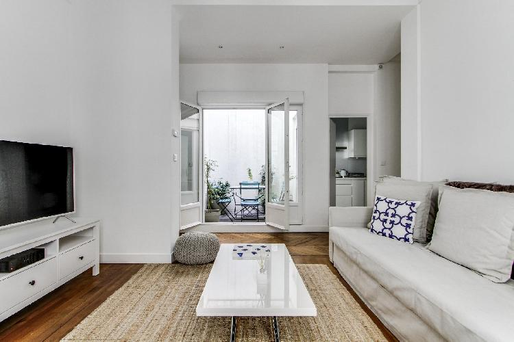 small private terrace with access from the living area in a 2-bedroom Paris luxury apartment