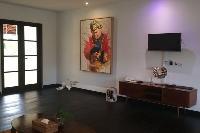 vibrant wall art in Bali - Villa Tjitrap luxury apartment