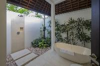 fancy outdoor bathtub of Bali - Villa Tjitrap luxury apartment
