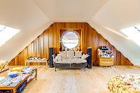 nice porthole above a sofa in Brittany - Luxury Sailor House