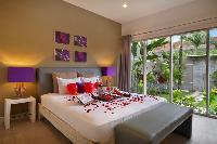 lovely master bedroom with a beautiful garden at Bali Cosy Villa luxury apartment