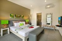 pristine bed sheets and pillows in Bali Cosy Villa luxury apartment