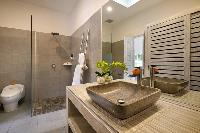 neat and trim toilet and bath in Bali Cosy Villa luxury apartment