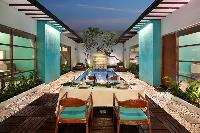 incredible alfresco dinners on the poolside deck of Bali - The Vie Villa luxury apartment