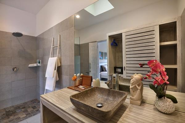 neat and nice bathroom with rain shower in Bali Cosy Villa Blue luxury apartment