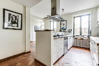 modern fully-equipped kitchen with ample closets and drawers in a 4-bedroom Paris luxury apartment
