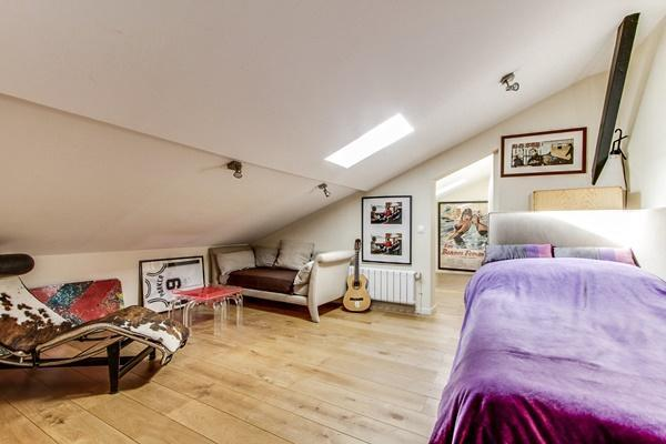 third bedroom on the attic with a double bed, a study or work space