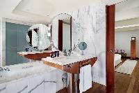 cool bathroom with tub in Arts Barcelona 1 Bedroom Penthouse luxury apartment