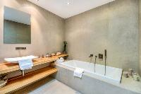 clean and fresh bathroom with tub in Corsica - Mediterranean luxury apartment