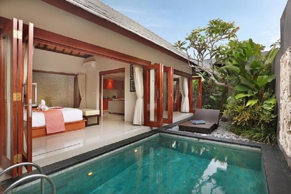 amazing bedroom with pool access at Bali - Legian Kriyamaha Villa 9 luxury apartment