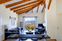 impressive ceiling beams of Corsica - Portigliolo luxury apartment