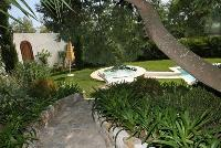 lovely and lush garden of Cannes Villa La Contemporaine luxury apartment