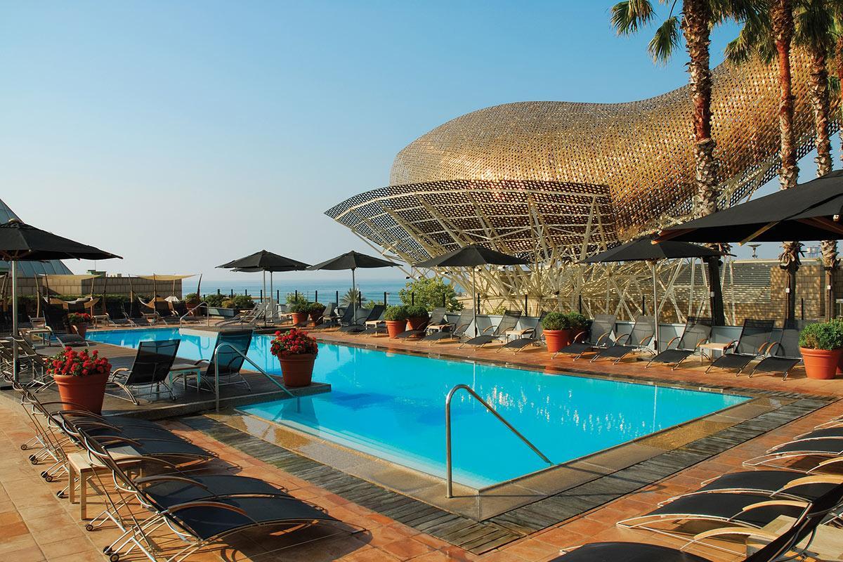 invigorating swimming pool of Arts Barcelona 3 Bedroom Penthouse luxury apartment