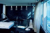cool bathroom of Arts Barcelona - The Royal Penthouse luxury apartment